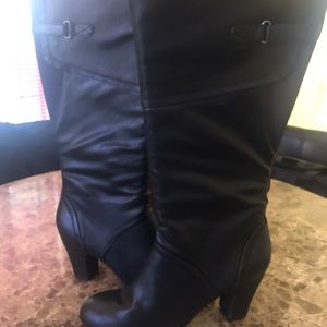 Cute black leather zip up heel boot.